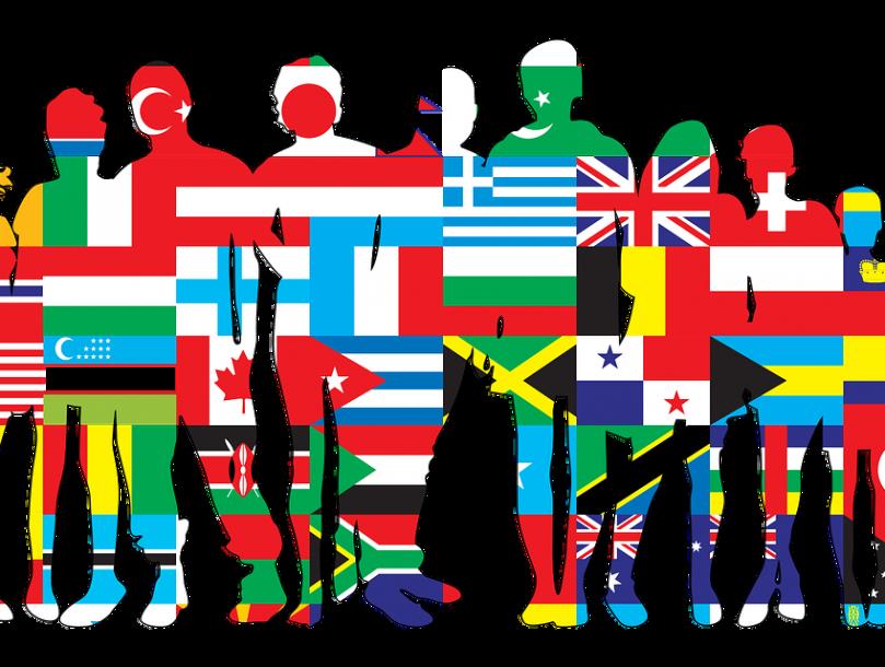 Ihmisryhmän siluetti, joka on täyetty eri maan lipuilla.